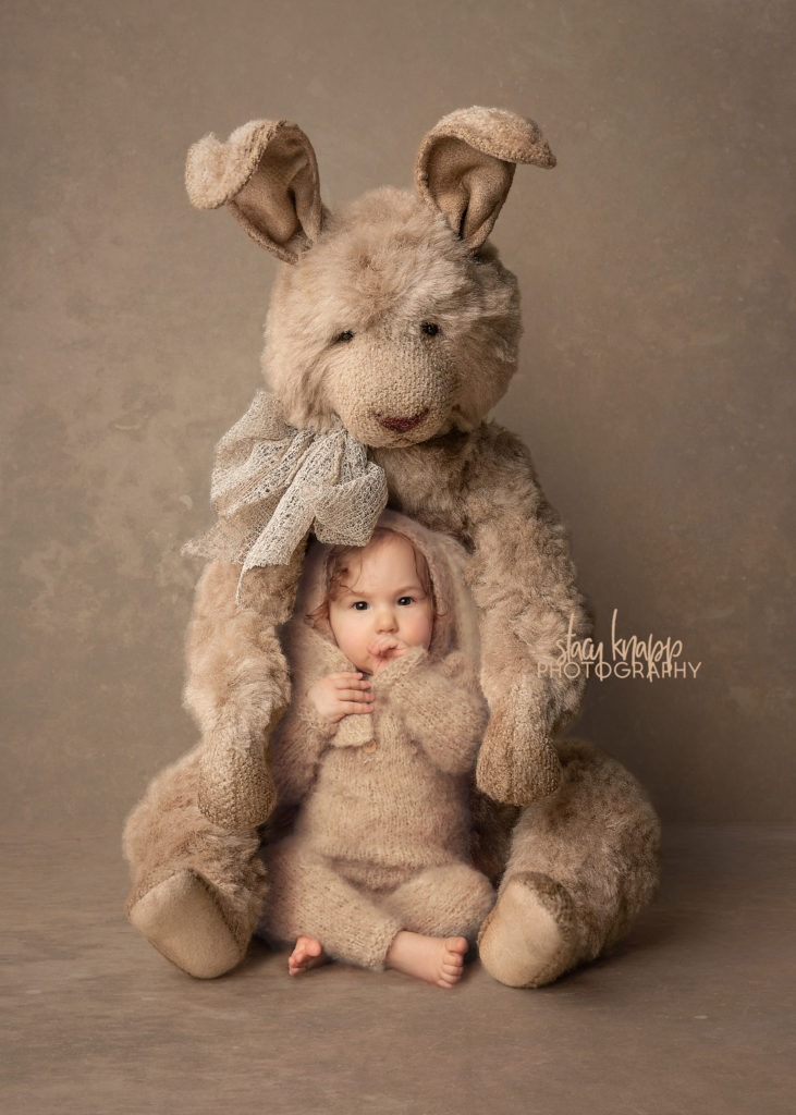 Easter photo of a baby girl in a bunny costume