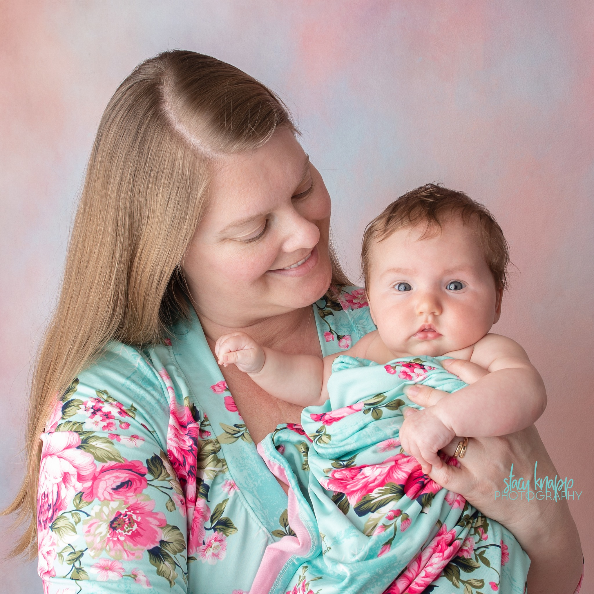 Mommy and me photo session with baby girl on pink backdrop