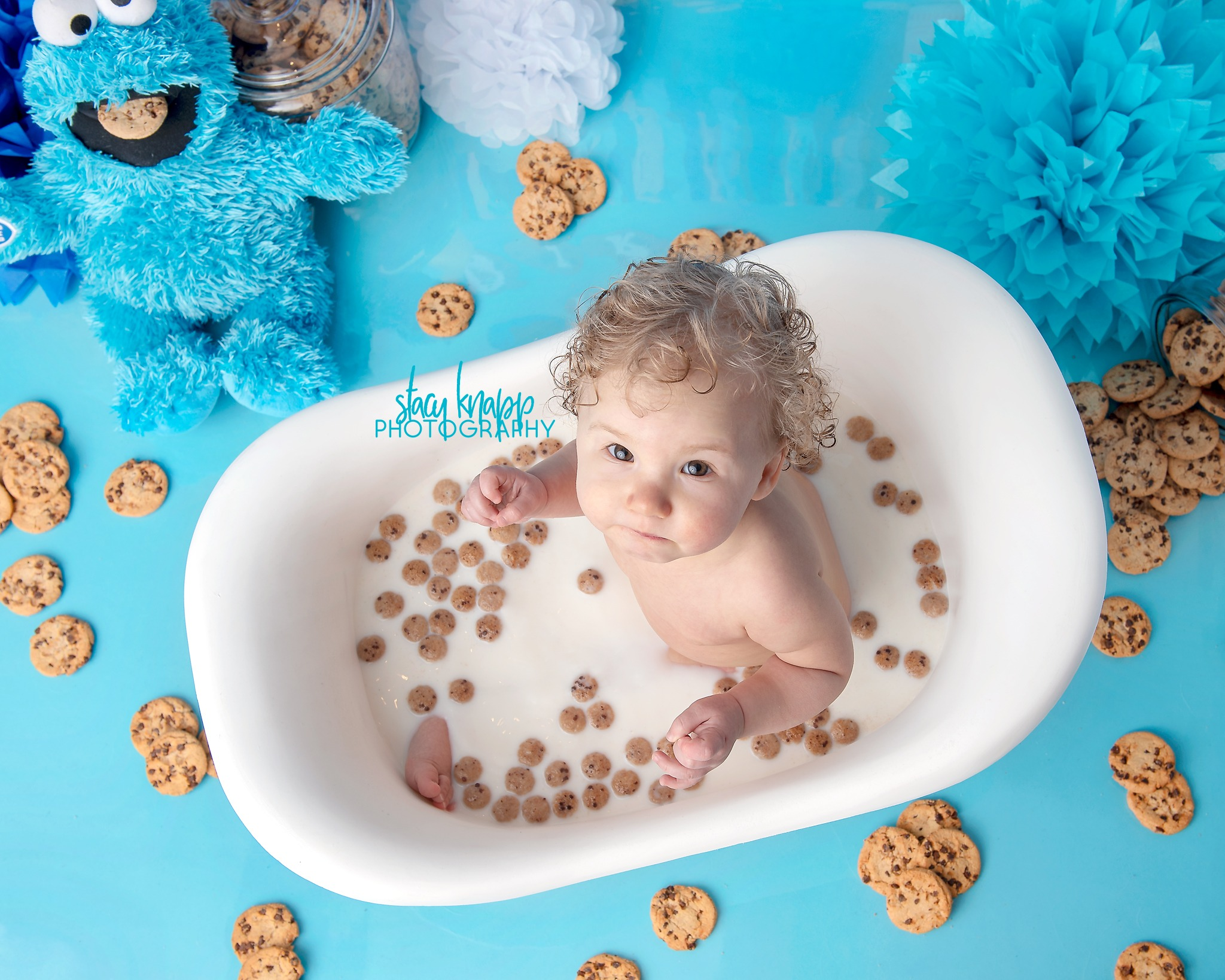 Baby girl in cookie monster bath during a splash session