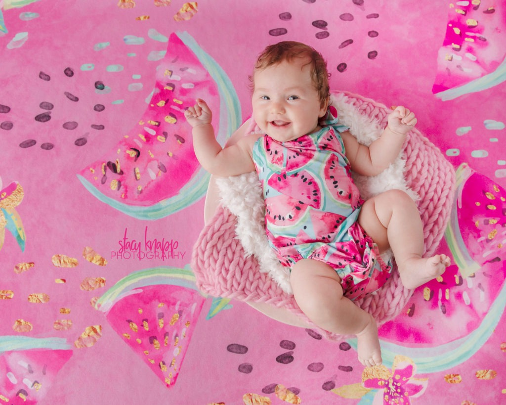 Baby girl photographed wearing watermelon outfit