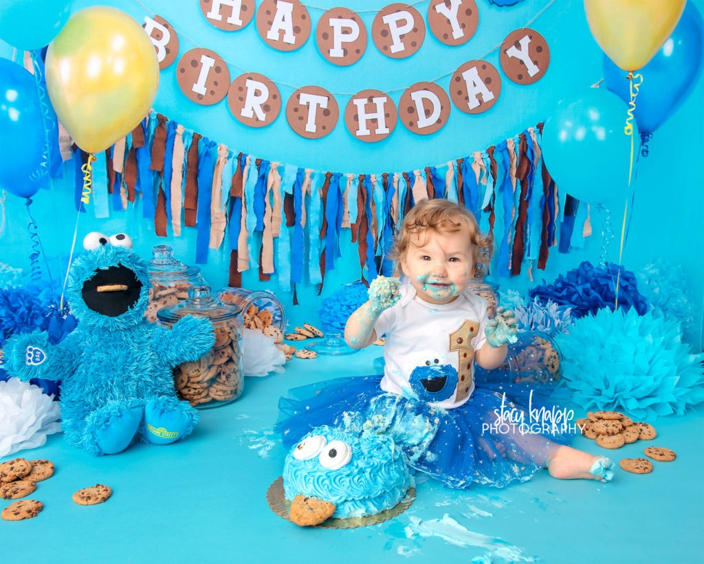 Cookie monster cake smash photograph with one-year old baby girl
