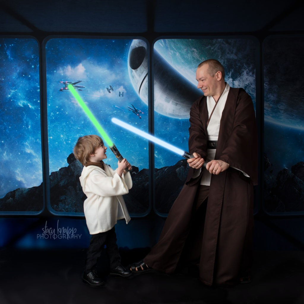 Star Wars photo of father and son having a lightsaber fight
