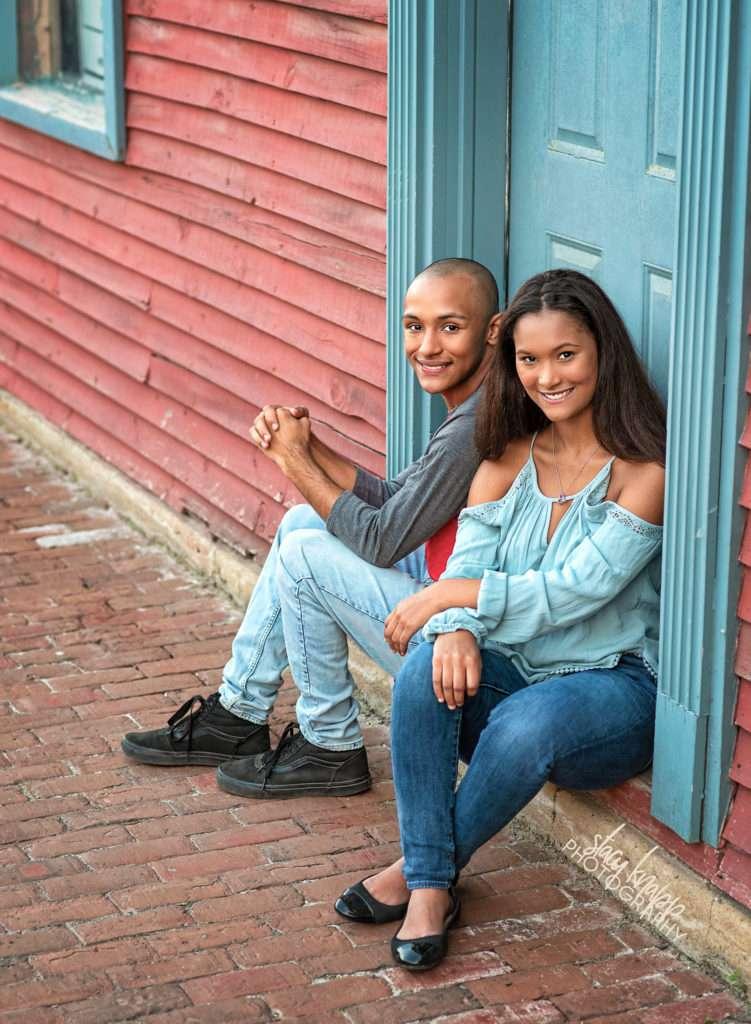 Senior twins sitting in door