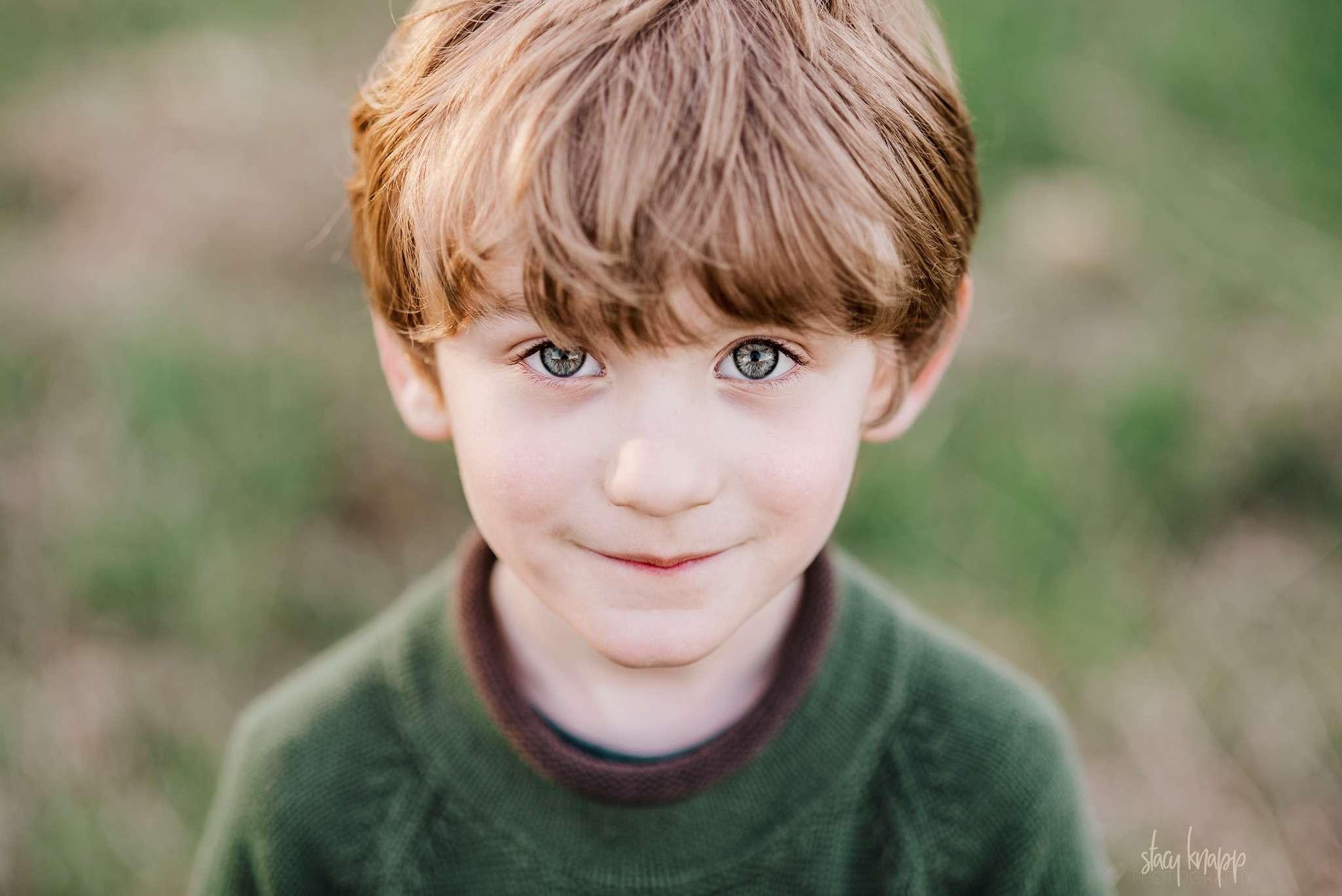 little boy in a field